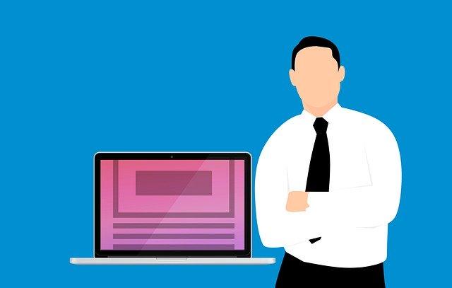 kreslený muž – obchodník opírající se o stůl s počítačem